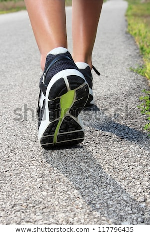 Close up on shoes, woman walking on running track Stock photo © Freedomz