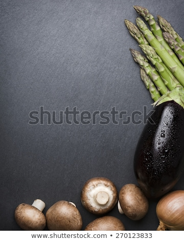 Stockfoto: Many Mushrooms Isolated On Stone Plate With Copyspace