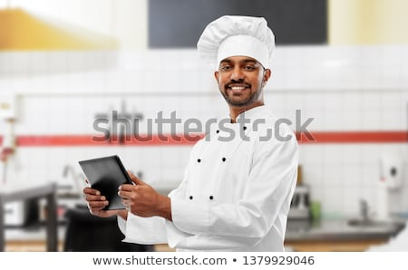 happy male indian chef with tablet computer Stock photo © dolgachov