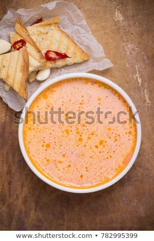Traditional Ukrainian Russian vegetable borscht soup on the old wooden background Stock photo © galitskaya