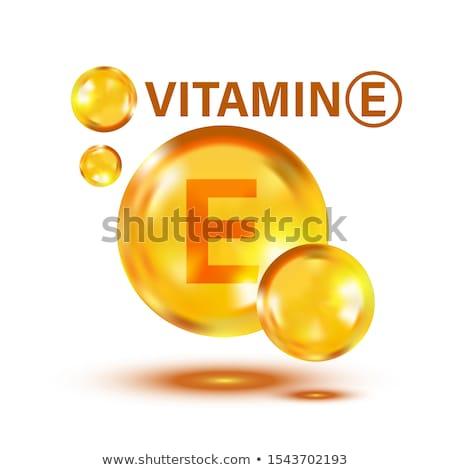 Capsule vitamina specchio superficie pesce olio Foto d'archivio © ShustrikS