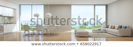 Interior of a modern home, view on dining room and kitchen. Stock photo © Lopolo
