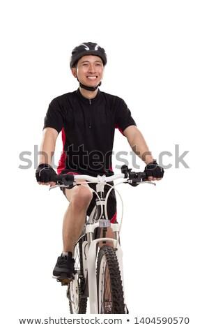 A biker man over a studio  white background Stock photo © Lopolo