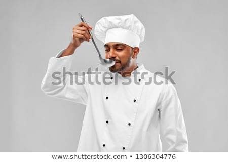 happy indian chef tasting food by ladle at kitchen Stock photo © dolgachov
