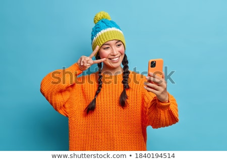 Woman Dressed in Warm Clothes, Posing with Phone Stock photo © robuart
