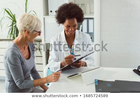 Doctor Showing Test Results To Patient Stock photo © AndreyPopov