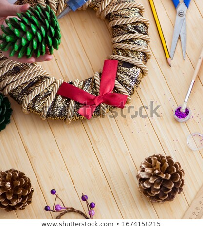 Woman doiing DIY festive decorations at home Stock photo © Elnur