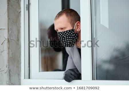 Adam siyah maske tıp eldiven bakıyor Stok fotoğraf © Illia