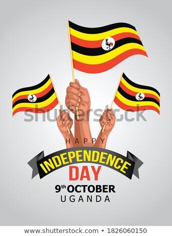 Uganda flag and hand on white background. Vector illustration Stock photo © butenkow