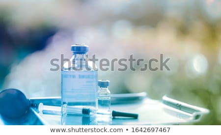 Vaccination, immunization and vaccine concept. Stock photo © olivier_le_moal