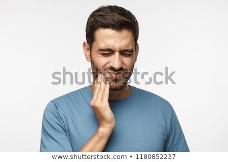 Dor de dente homem mão cara Foto stock © imarin