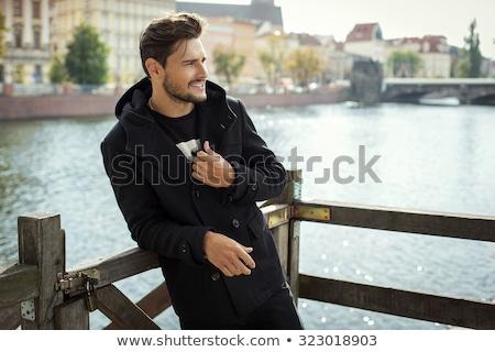 Homem posando marina céu sorrir cabelo Foto stock © photography33