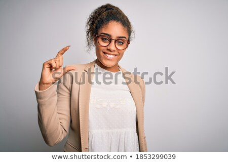 Businesswoman pinching finger sign Stock photo © ia_64