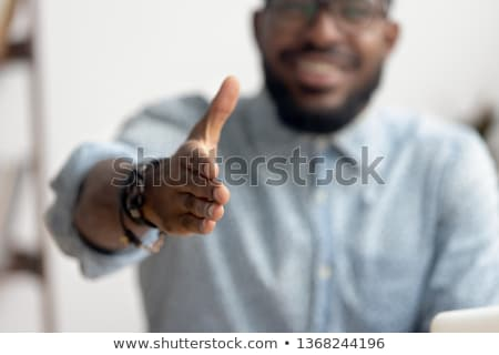 business man extending hand to shake stock photo © zurijeta