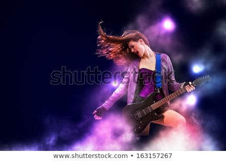 Stock photo: Passionate Young Woman Guitarist Playing
