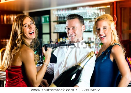Glamorous woman pulling man by his tie Stock photo © stockyimages