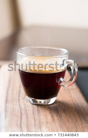 Black coffee and froth in glass mug with sugar Stock photo © backyardproductions