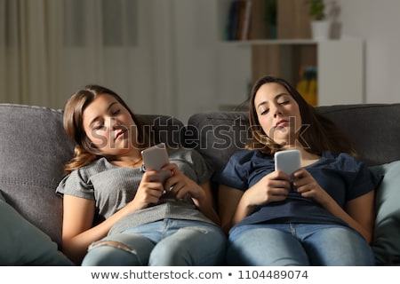 Bored female sitting on couch Stock photo © sumners