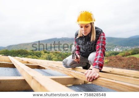 Young roofer with hammer Stock photo © photography33