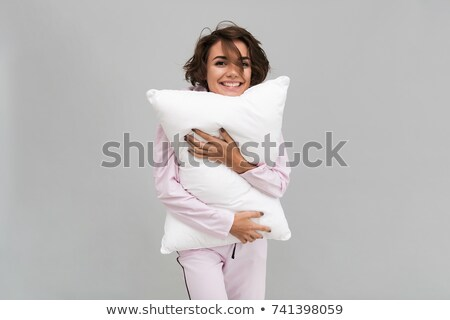 Stock photo: Portrait of a cute woman holding a pillow
