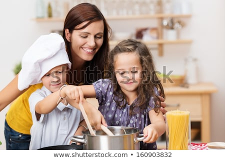 Woman in kitchen with pasta Stock photo © photography33