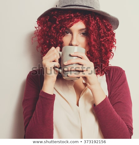 Stock photo: Red-haired girl with cup.