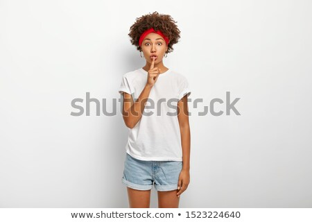 Young Woman Gesturing for Quiet or Shushing Stock photo © PawelSierakowski