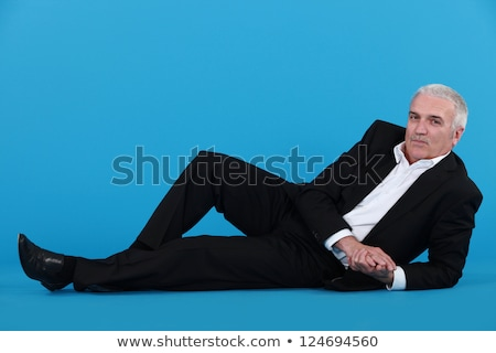 Stock fotó: Grey Haired Businessman Laying On The Floor