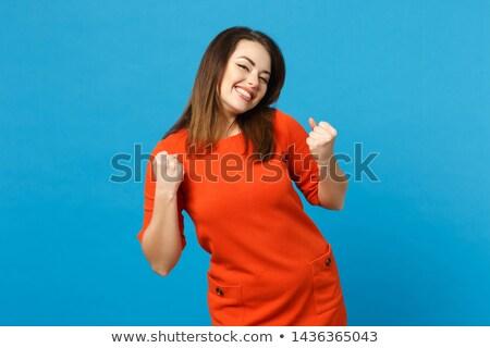 Charmig young woman saying good luck Stock photo © pablocalvog