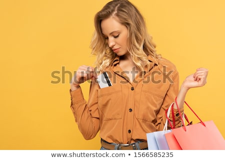 Stock photo: blond woman put in card into bag