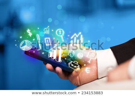 Businessman Holding Cell Phone Displaying Graph Stock photo © AndreyPopov