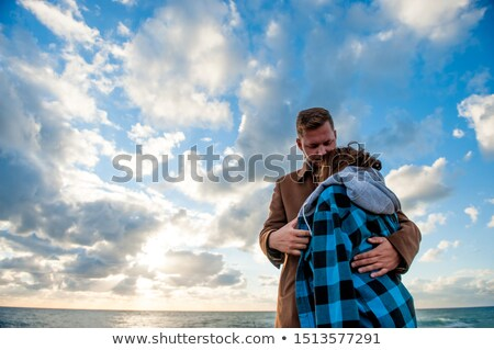Tough man and his lovely wife Stock photo © konradbak