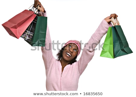 Red and green Christmas presents - African American woman Stock photo © dgilder