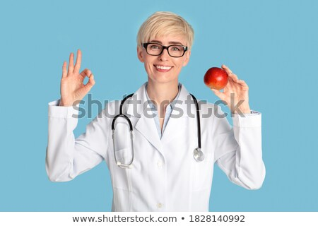 female doctor holding healthy diet sign stock photo © ichiosea