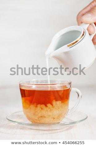 Vetro Cup piattino mano primo piano grigio Foto d'archivio © mizar_21984
