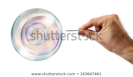 Bubbles inside of a Bubble about to explode by a needle Stock photo © klublu