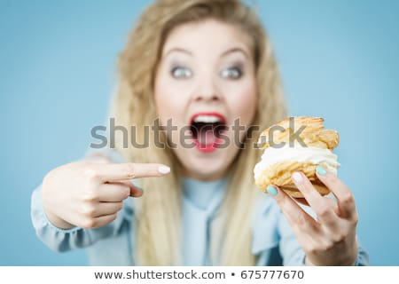Woman wants to eat a cupcake Stock photo © Nobilior
