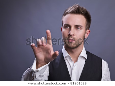 Portrait of young man presses finger something Stock photo © cherezoff