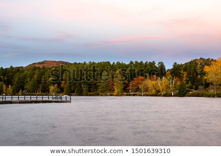 Deserted jetty surrounded by the water Stock photo © olandsfokus