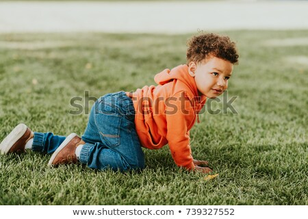 trendy 2 years old baby boy playing in park stock photo © vladacanon