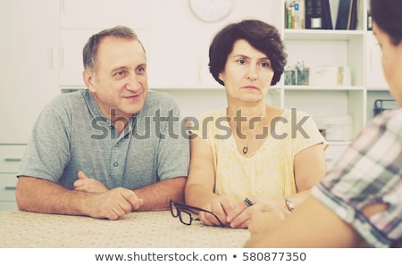 Serious Senior Man With Adult Daughter At Home Stock photo © HighwayStarz