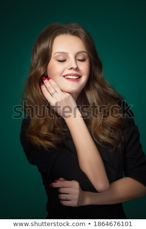 glamorous woman posing with her eyes closed stock photo © feedough