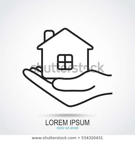 female hand holding house icon stock photo © cherezoff