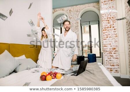 Sitzung glücklich Paar Geld Luft Stock foto © juniart
