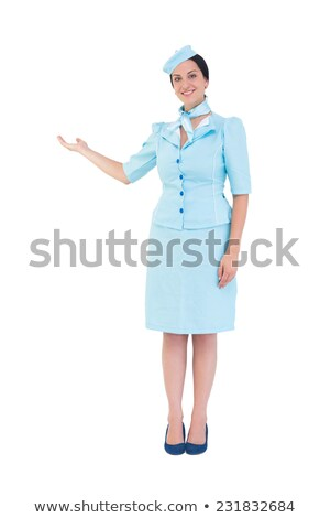 Pretty air hostess presenting with hand Stock photo © wavebreak_media