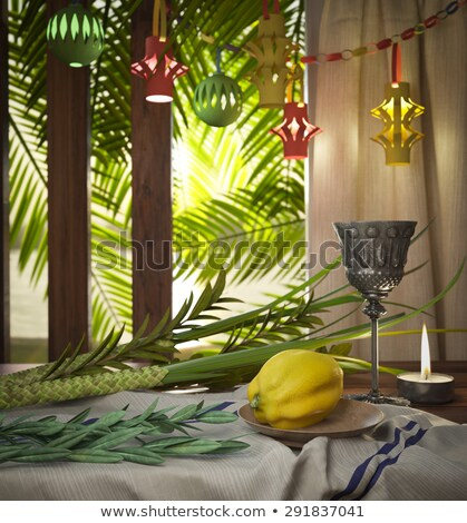 Symbols Of The Jewish Holiday Sukkot With Palm Leaves And Candle Stok fotoğraf © denisgo