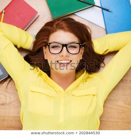 Redhead young woman lying on the floor Stock photo © konradbak