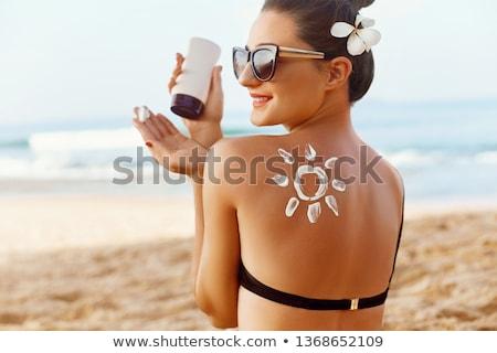 Nina solar loción ilustración playa belleza Foto stock © adrenalina