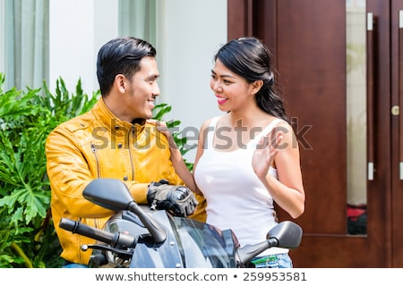 Woman saying goodbye to motorcyclist Stock photo © Kzenon