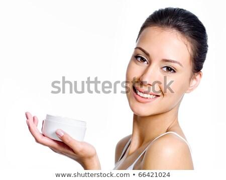 Woman holding moisturizing facial cream  Stock photo © deandrobot
